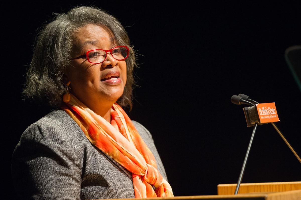 President Katherine Conway-Turner at podium